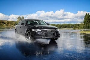 audi a6 on wet road